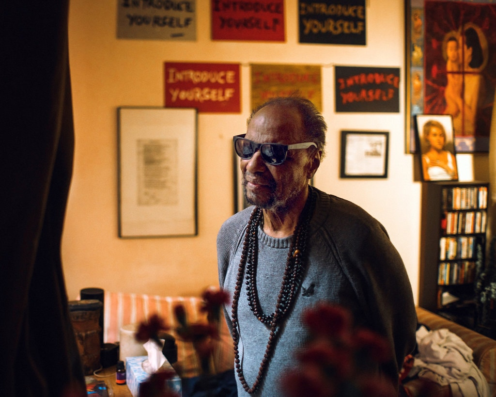 Steve Cannon at his townhouse in the East Village in 2014 as he was preparing to move out. He had overseen a salon there, opening his doors and welcoming artists, musicians, poets and others to join a conversation that meandered for decades. Credit: Adam Golfer | NYTimes.com