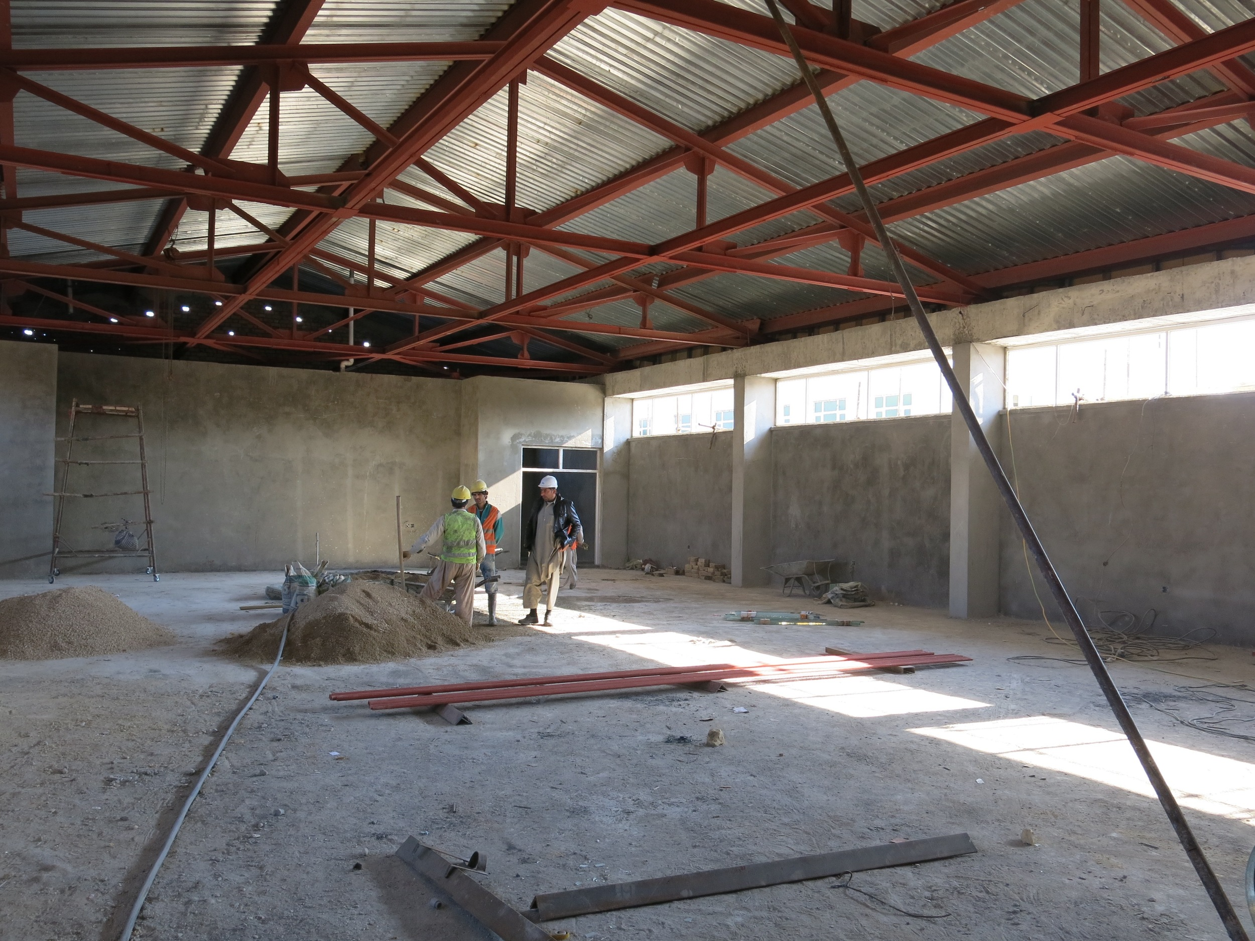 Long span structure under construction for the first women's assembly hall. Faryab Afghanistan.