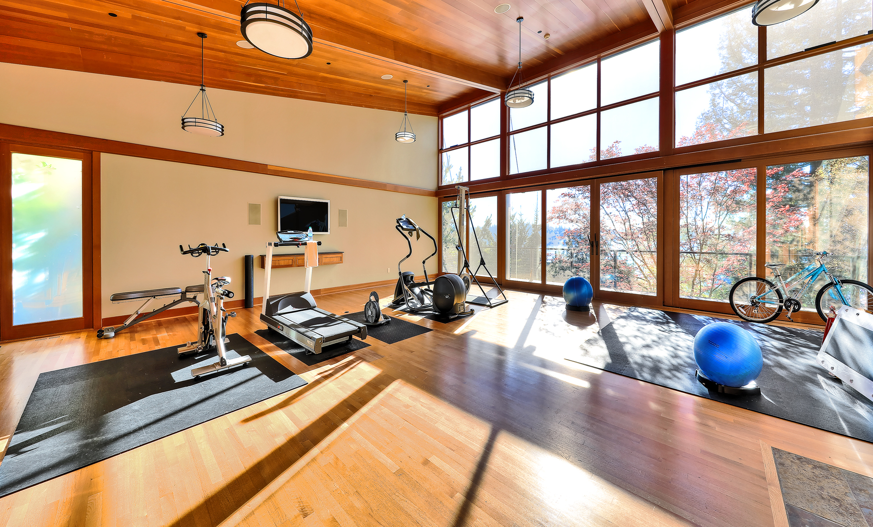 Photo of fitness room with high ceiling designed by a Seattle Residential Architect