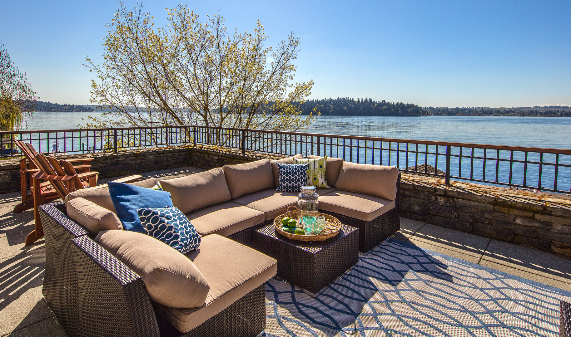 Photo of back patio of lakefront PNW home designed by Seattle Residential Architect