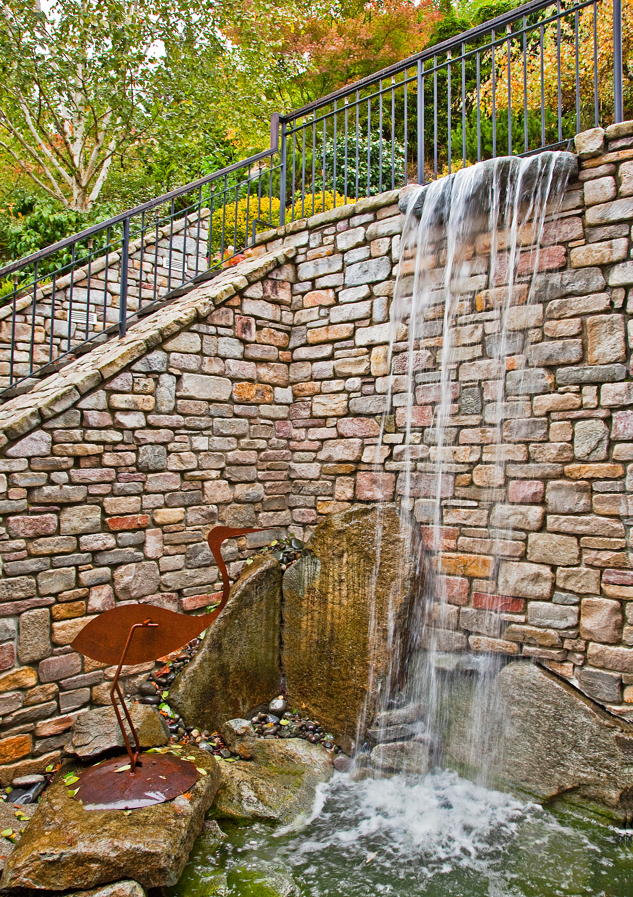 Waterfall built into residential design by Seattle architecture firm TCA Architecture