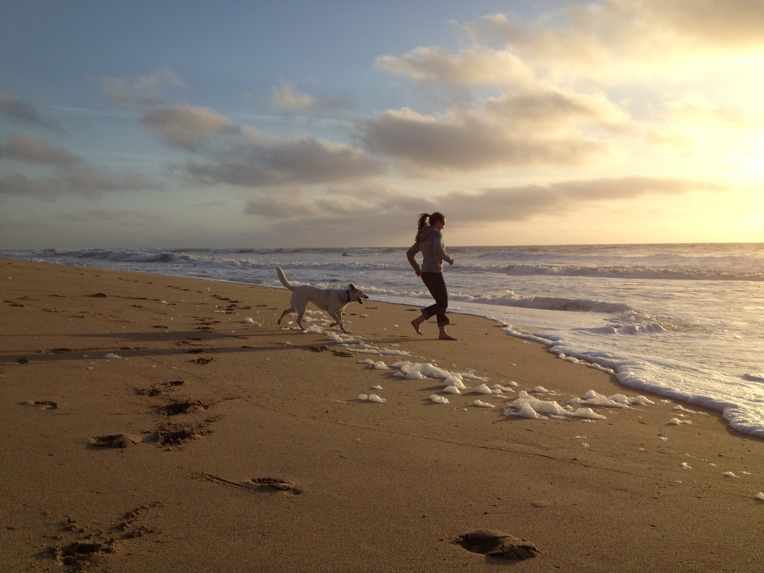 Althea Rogers and her dog Isa on the beach at Half Moon Bay, California. (Photo by Emily Stifler Wolfe)