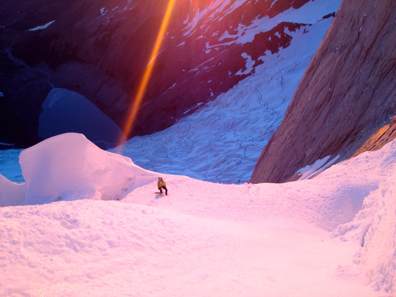 Dawn illuminates Anne Gilbert Chase on Aguja Poincenot. Fitz Roy Range, Patagonia, Argentina. (Photo by Emily Stifler Wolfe)