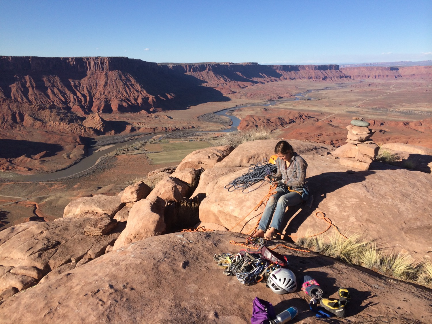 A climber atop Parriott Mesa, Castle Valley, Utah. (Photo by Emily Stifler Wolfe)