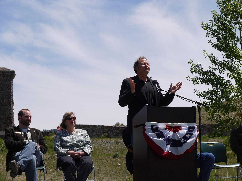 Former Montana Governor Brian Schweitzer speaks beside Roosevelt Arch, Yellowstone National Park. (Photo by Emily Stifler Wolfe)