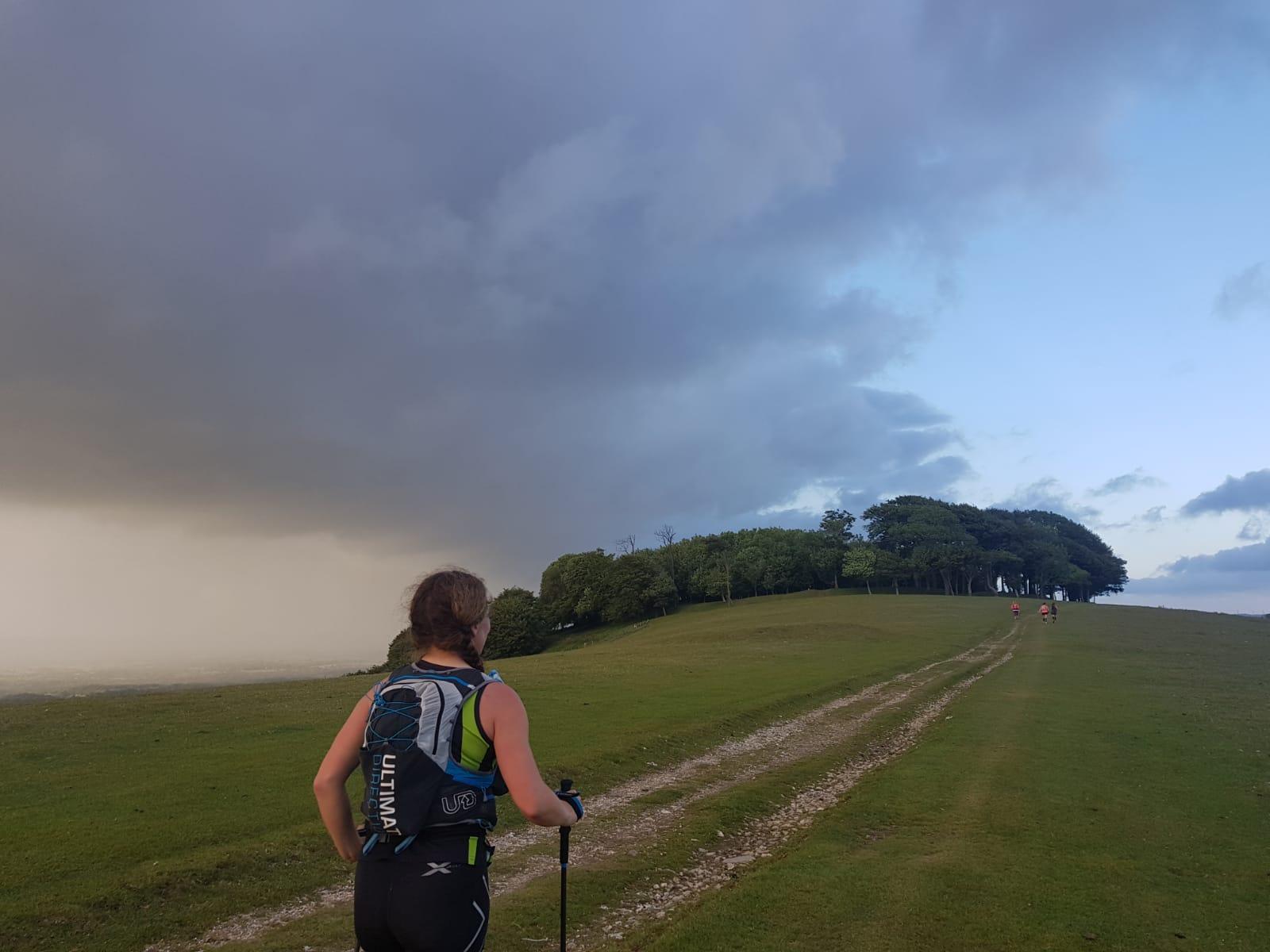 Rosanna walks towards sunset on the SDW100 2019