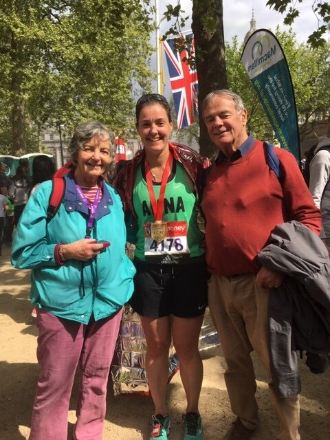 "Anna at London marathon 2017 with her parents. ""I really wanted them to come and watch as it was my first uk marathon but Mum had just had chemo a month earlier and was pretty tired. They saw me twice on course and at the end! And she made the best banner that I could see miles away, but I don't have a photo with them and the banner in!"""