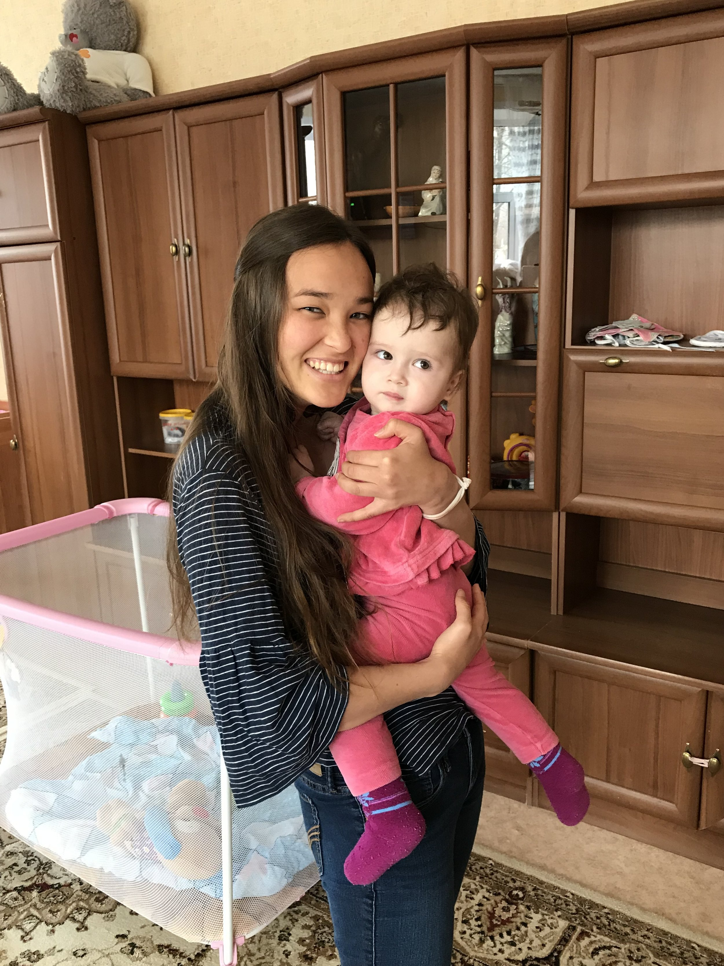 Holding cute babies at the orphanage