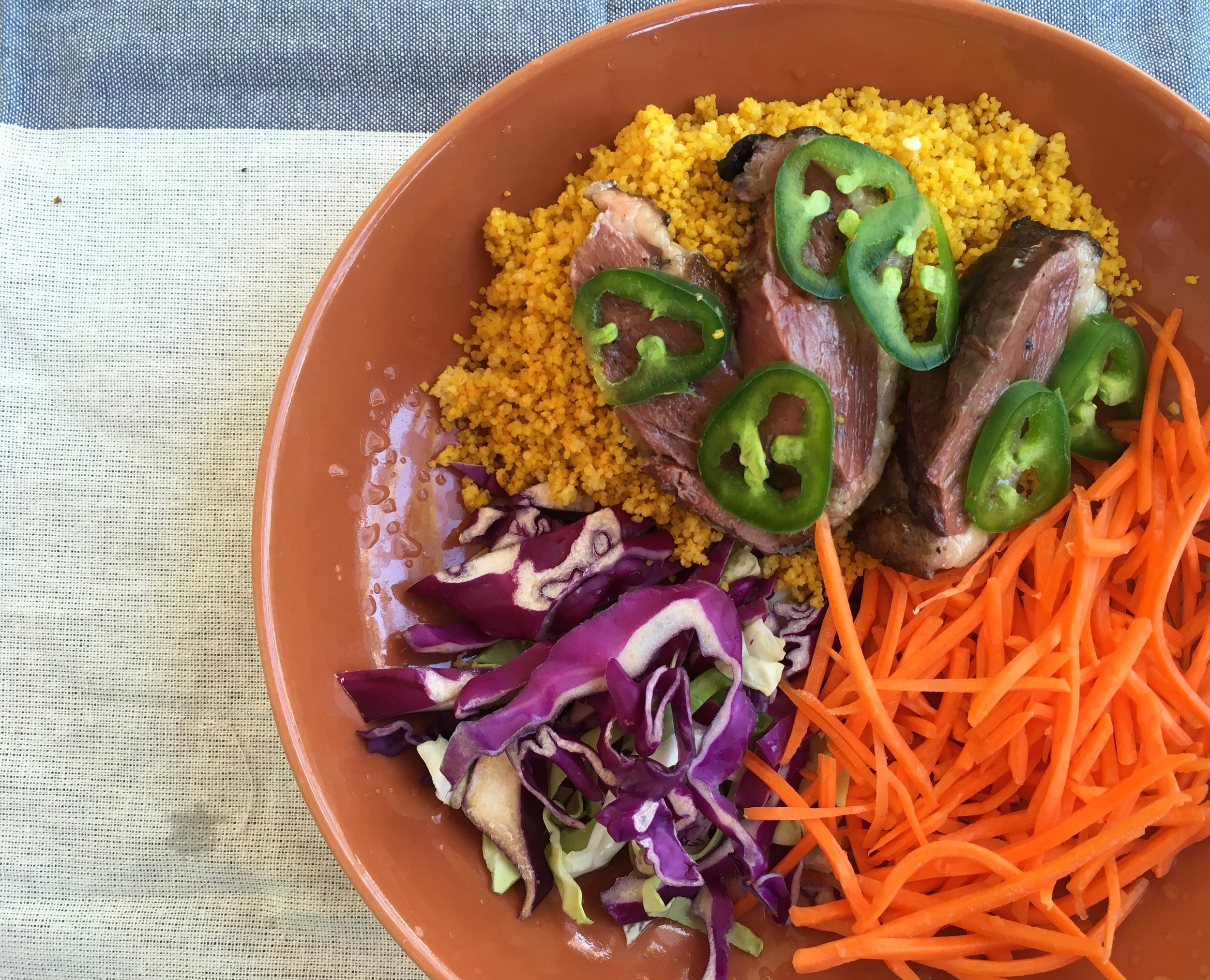 grilled moulard duck breast with turmeric couscous, carrots, cabbage and jalapenos