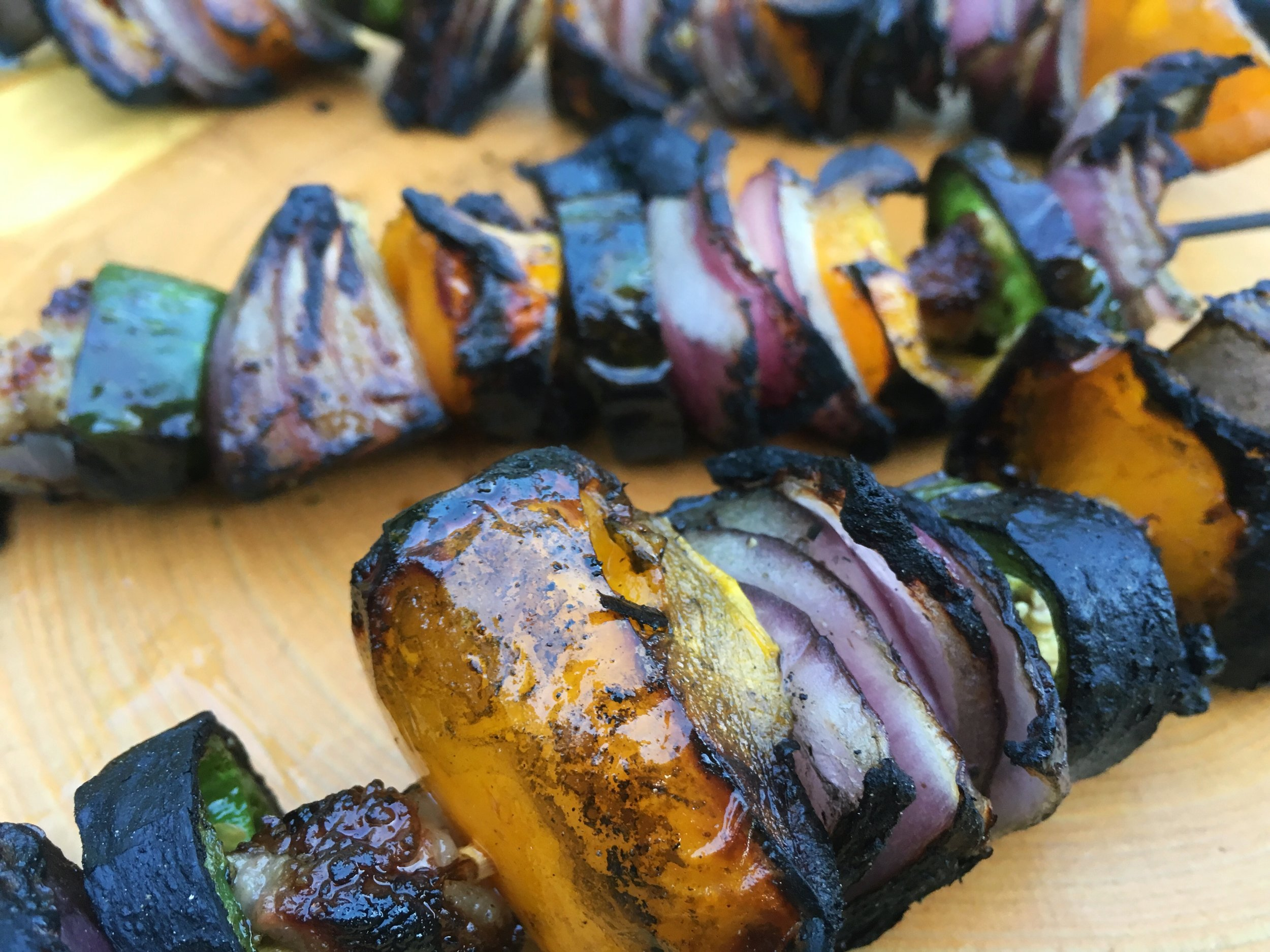 Grilled veggie skewers with duck fat, jalapenos, yellow peppers, and red onions