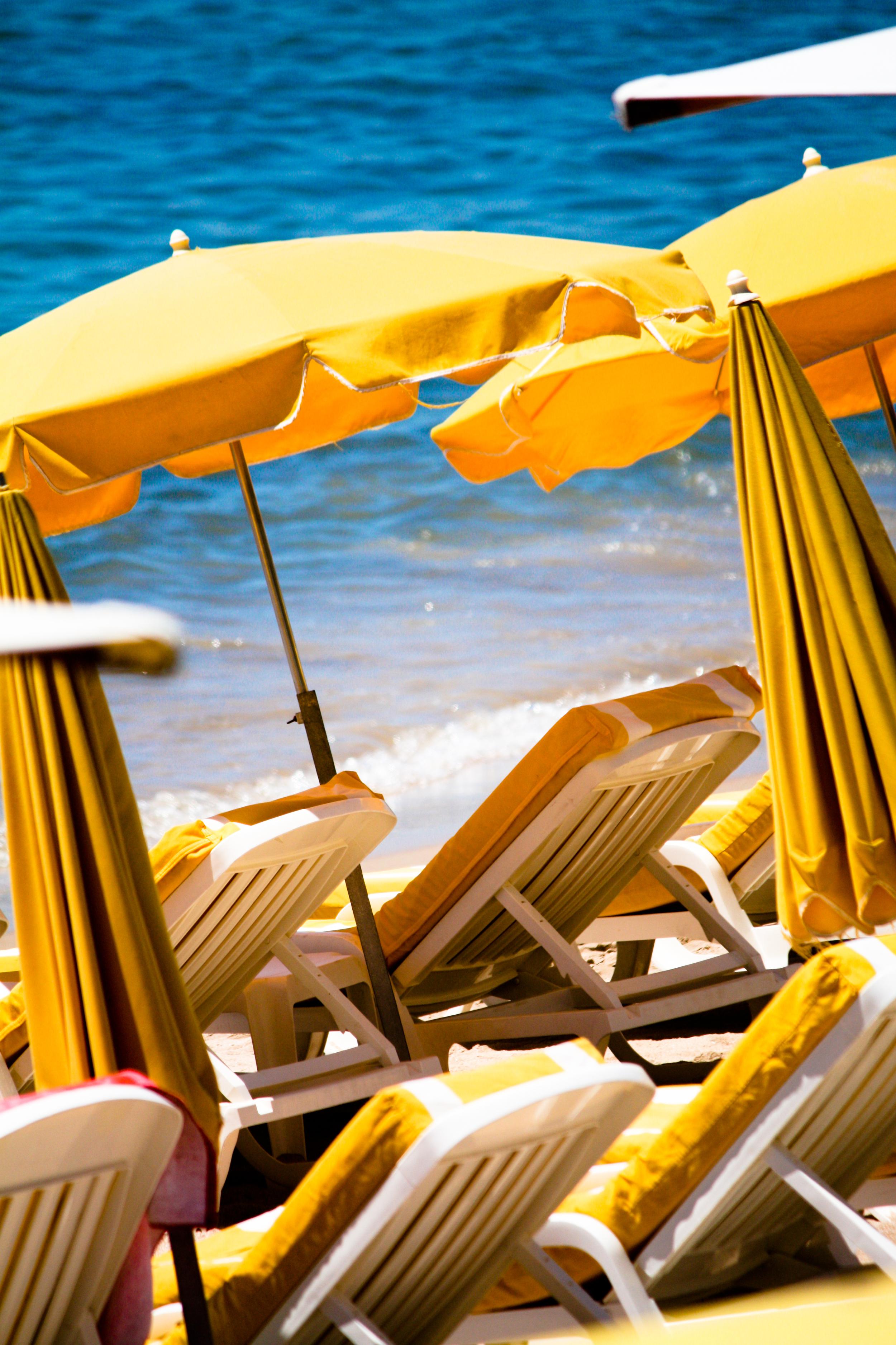 @rebeccaplotnick Caanes France beach umbrellas