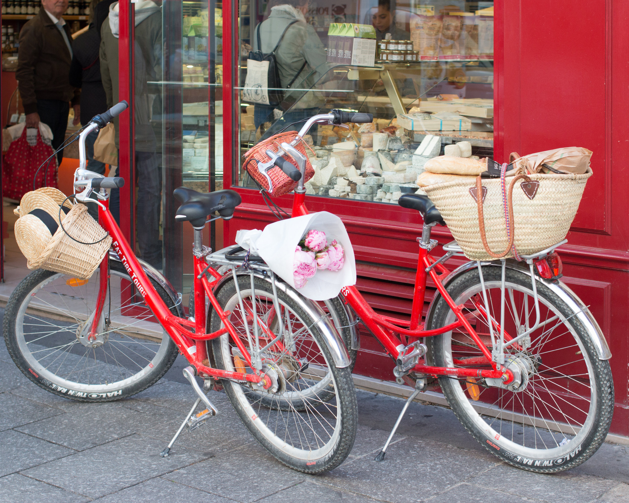 fat tire with everyday parisian rue cler picnic supplies in paris france