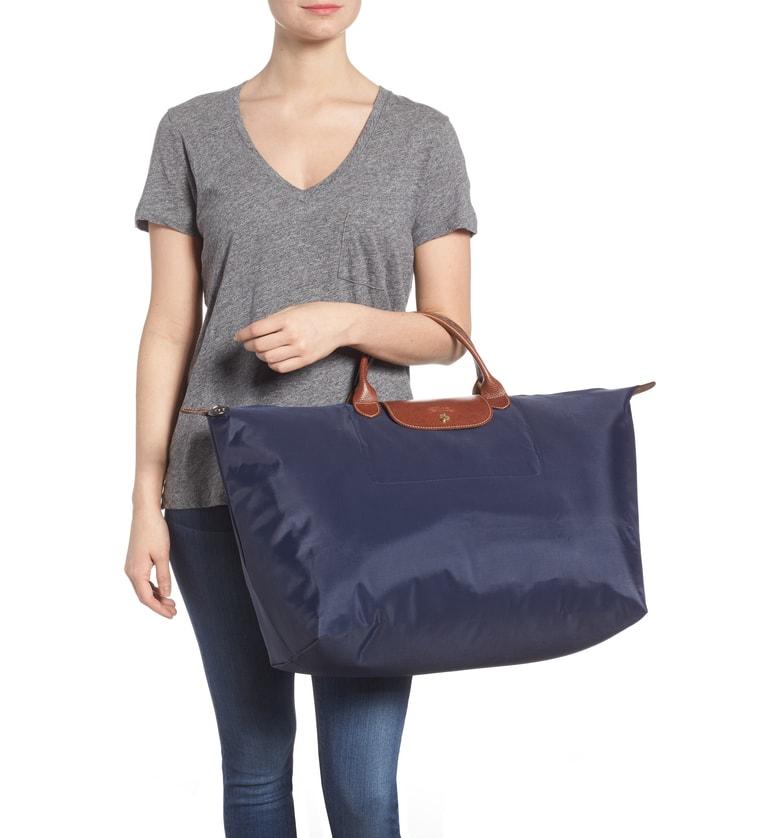 - Longchamp Weekender $135