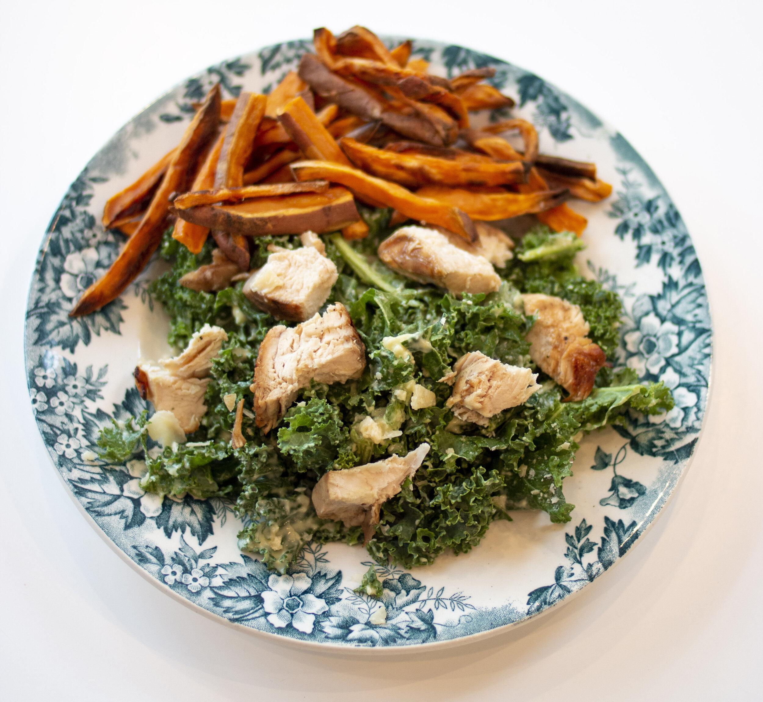 Kale Caesar Salad and Sweet Potato Fries