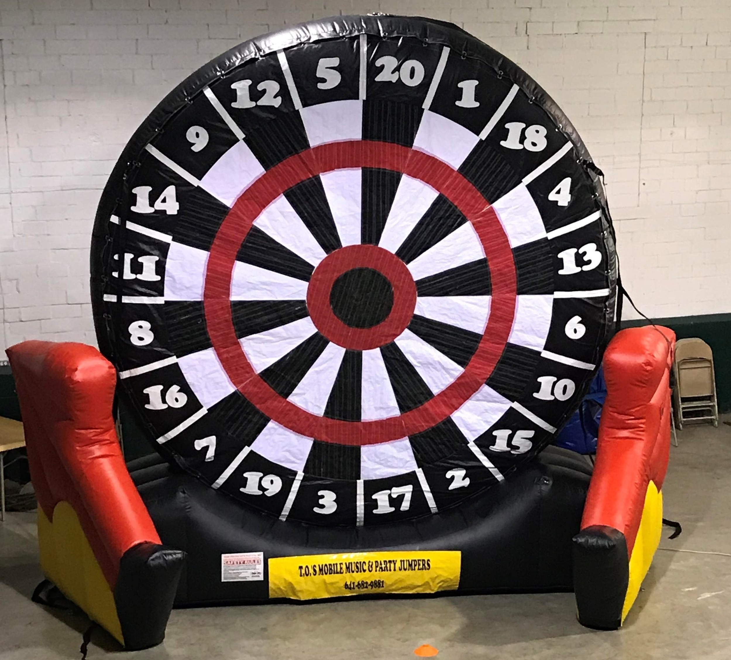 FOOT DARTS$150.00 + TAX - Giant 16 ft. X 20 ft. dart board comes with 6 Velcro balls to provide a entire day of fun for all ages. Balls are easily removed with a built in strap that knocks the balls loose and back to the ground.