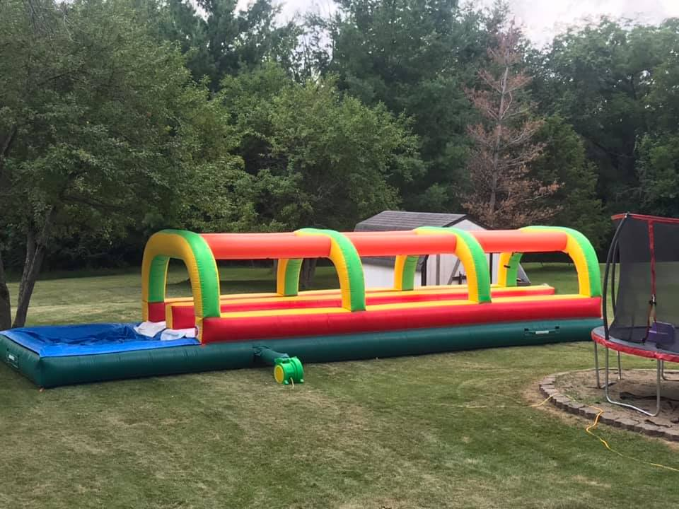 Slip-N-slidewith pool$215.00 + tax - 33 ft. long plus an additional 10 ft. pool our No Soap & No harsh Chemicals needed Slip-N-Slide is the easiest way to have the most fun on those hot summer days.Water drips from the top directly down onto the slide and hose requires no adjustments throughout the day.