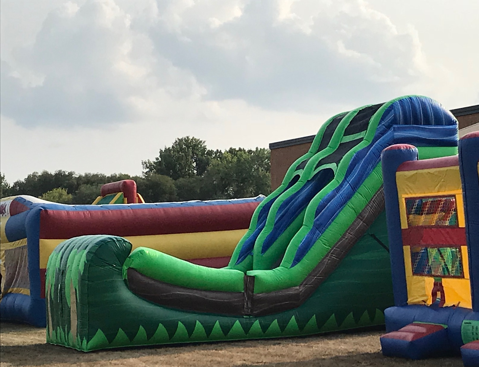 16ft. Jungle slidedry- $195.00 + taxWET- $235.00 + tax - Slides may be used as normal dry slide or can be hooked up to a water hose for a amazing water slide experience that makes hot summer days the best ever!