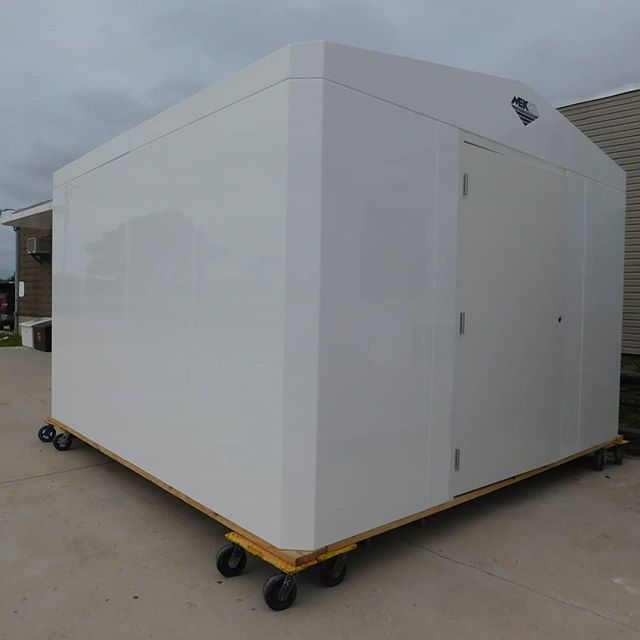 """12' x 12' x 7'4"""" Eave Standard Building - White, high gloss gel coat exterior - 2/12 pitch gable roof - R21 Sandwiched composite structural insulation system - One piece, permanently fused, factory assembled watertight structure - Open bottom - Estimated total weight 2,075# - 4' x 6'8"""" Grade I door - Interior lighting - Rigid PVC conduit  #mekco #mekcofiberglass #mekcocustom #mekcofrp #fiberglass #wastewater #watertreatment #wastewatertreatment #frpstructures #frpenclosure #frpbuilding #madeinwisconsin #madeinwis #madeinamerica"""