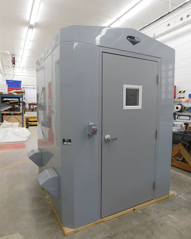 """6'L x 6'W x 7'4"""" Eave Height, molded, insulated F.R.P. building constructed complete with the following details and features: Gray, high gloss, molded gel coat exterior color, visually aesthetic, UV stable and maintenance free 2/12 pitched gable roof, with integrally molded F.R.P. clear span trusses. Sandwiched composite structural insulation system – yielding a nominal R14, all walls and roof. White corrosion resistant vinyl ester interior surfaces – all walls and roof. One piece, permanently fused, factory assembled watertight structure. Integrally molded, full perimeter, 4"""" internal F.R.P. pre-drilled anchoring flange, complete with 3/8"""" neoprene base gasket. No floor is provided.  Open bottom for drop over placement and removal. Internal partition wall creating two separate rooms. Removable 1/2"""" galvanized lifting eye. Estimated total weight 700#. Two ea. - 3'0 x 6'8, insulated, commercially manufactured, Grade I, white F.R.P. access doors, complete with pultruded F.R.P. frames, thresholds and drip edges, weather seals and sweeps, 10"""" x 10"""" insulated windows, pneumatic closers, panic hardware, heavy duty stainless steel 4-1/2"""" x 4-1/2"""" triple butt hinges and keyed alike entry locksets. 42"""" x 48"""" hardcore interior reinforcement panel . Three ea. – Cylinder brackets as described in spec. Complete factory pre-assembly and installation of electrical equipment as follows: oTwo ea. - 10"""", 379cfm @ .125"""" SP, F.R.P. shutter mounted exhaust fans in custom molded wall openings, with F.R.P. rain canopies, wired to exterior light switch. Fans will be pre-installed, detached and packaged separately to prevent damage in transit. oTwo ea. - 10"""" x 10"""" F.R.P. gravity intake dampers in custom molded wall openings, with insect screens and extruded aluminum exterior louvers.  oTwo ea. - 24"""", LED, vapor tight, 120V light  oAll wiring #12 THHN stranded copper in rigid PVC, stubbed at common junction. 35 psf roof / 25 psf wind loads. Structural design calculations  #mekco #mekcofiberg"""