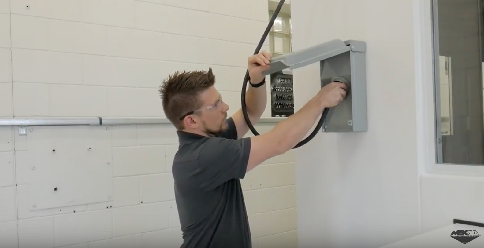 Adam plugging in the single power connection outlet