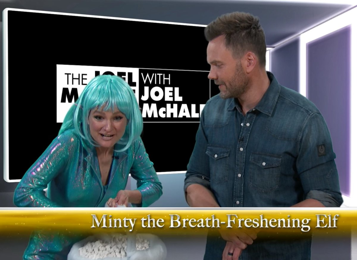 Delaney as her BELOVED  Joel McHale Show  character, Minty the Breath-Freshening Elf… and Joel