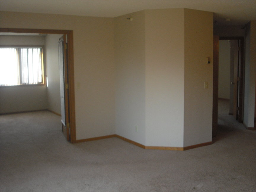 Vacant unit living room and bedroom.JPG