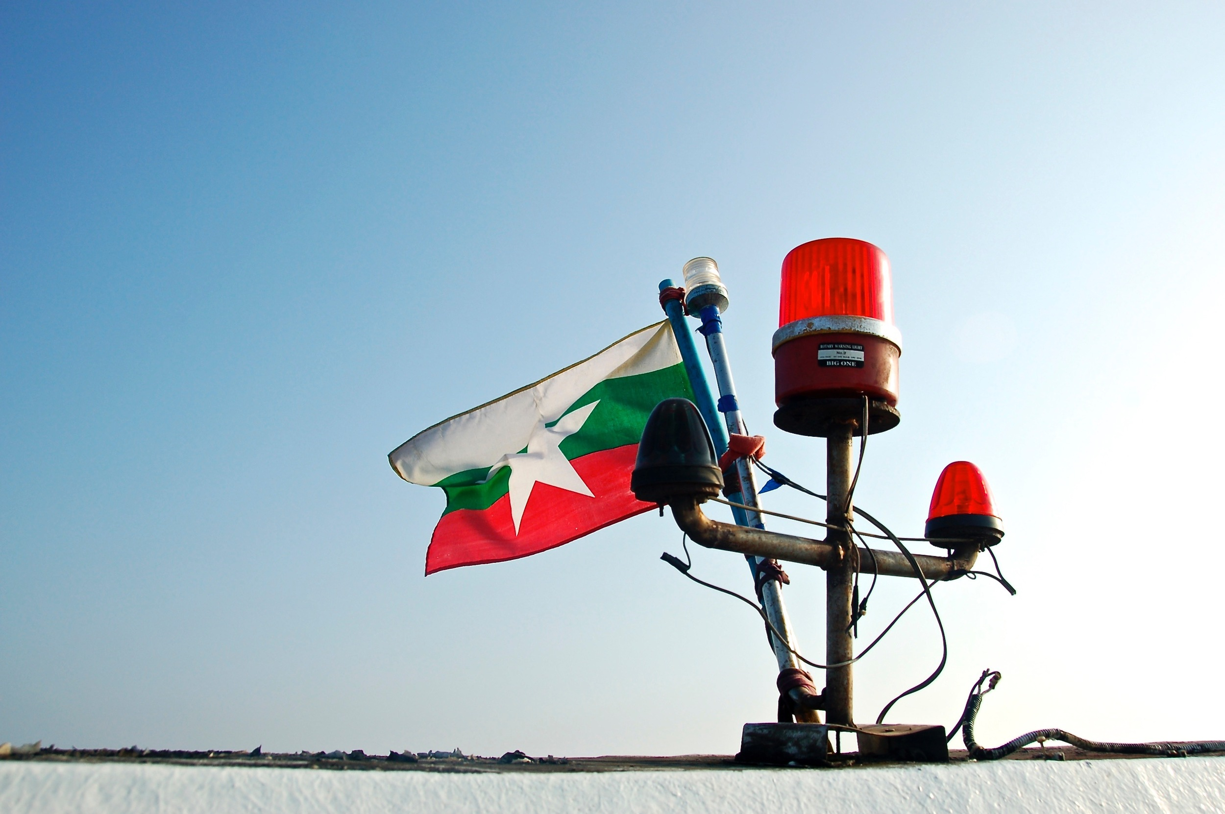 Flag and Lights atop boat in Myanmar
