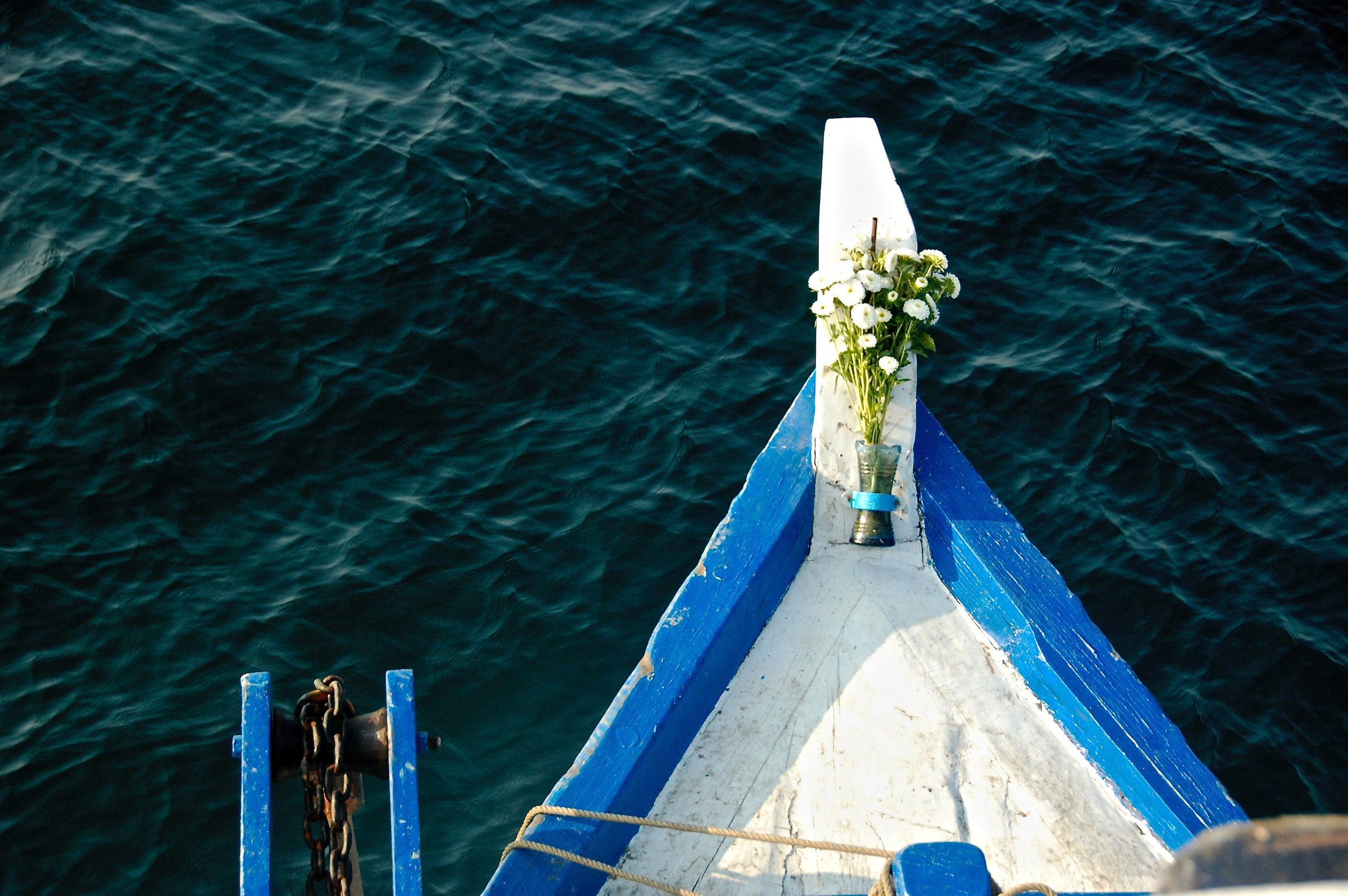 Many boats placed flowers on their bow as an offering to the sea-gods