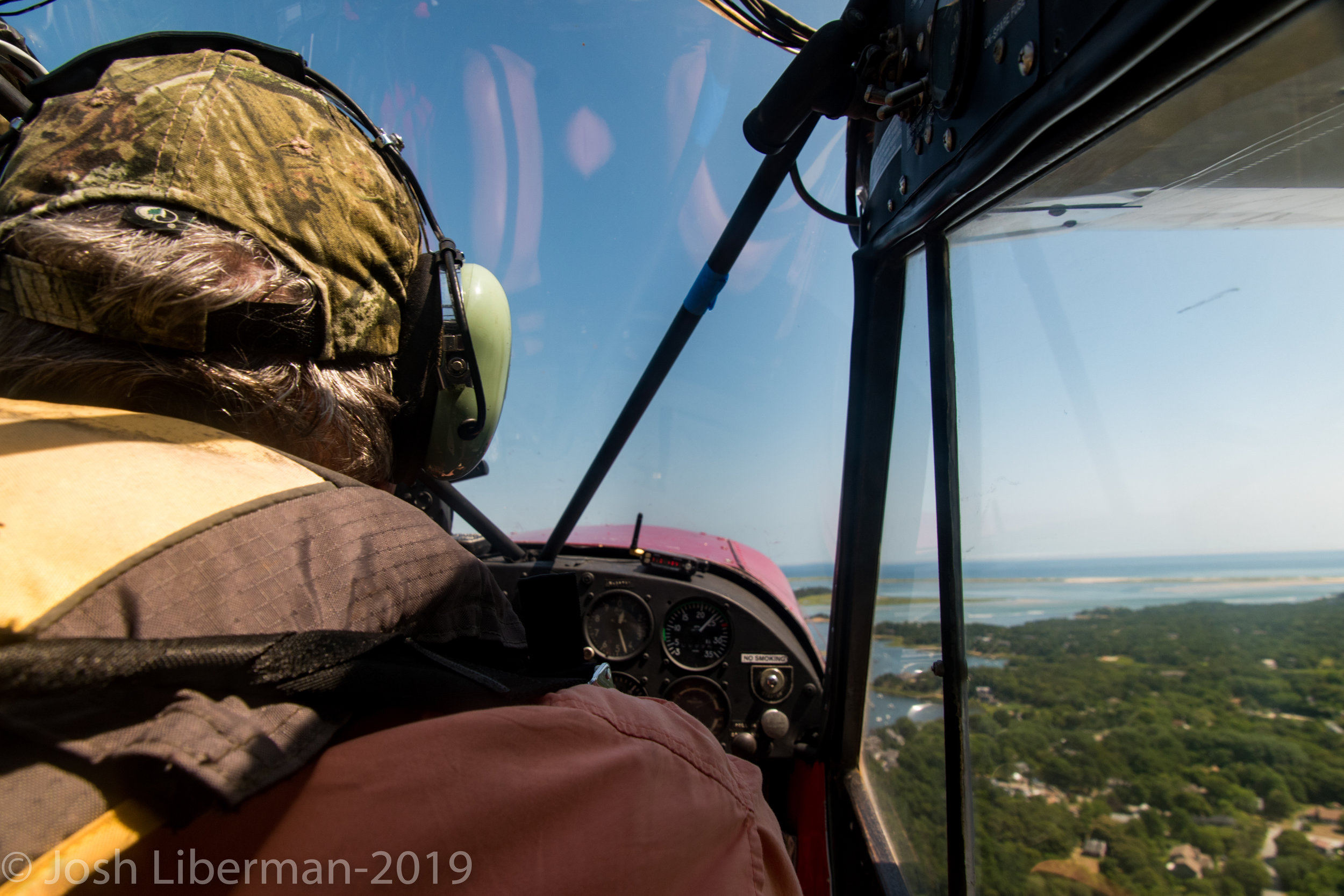 Pilot George Breen looks for white sharks off the coast of Cape Cod.
