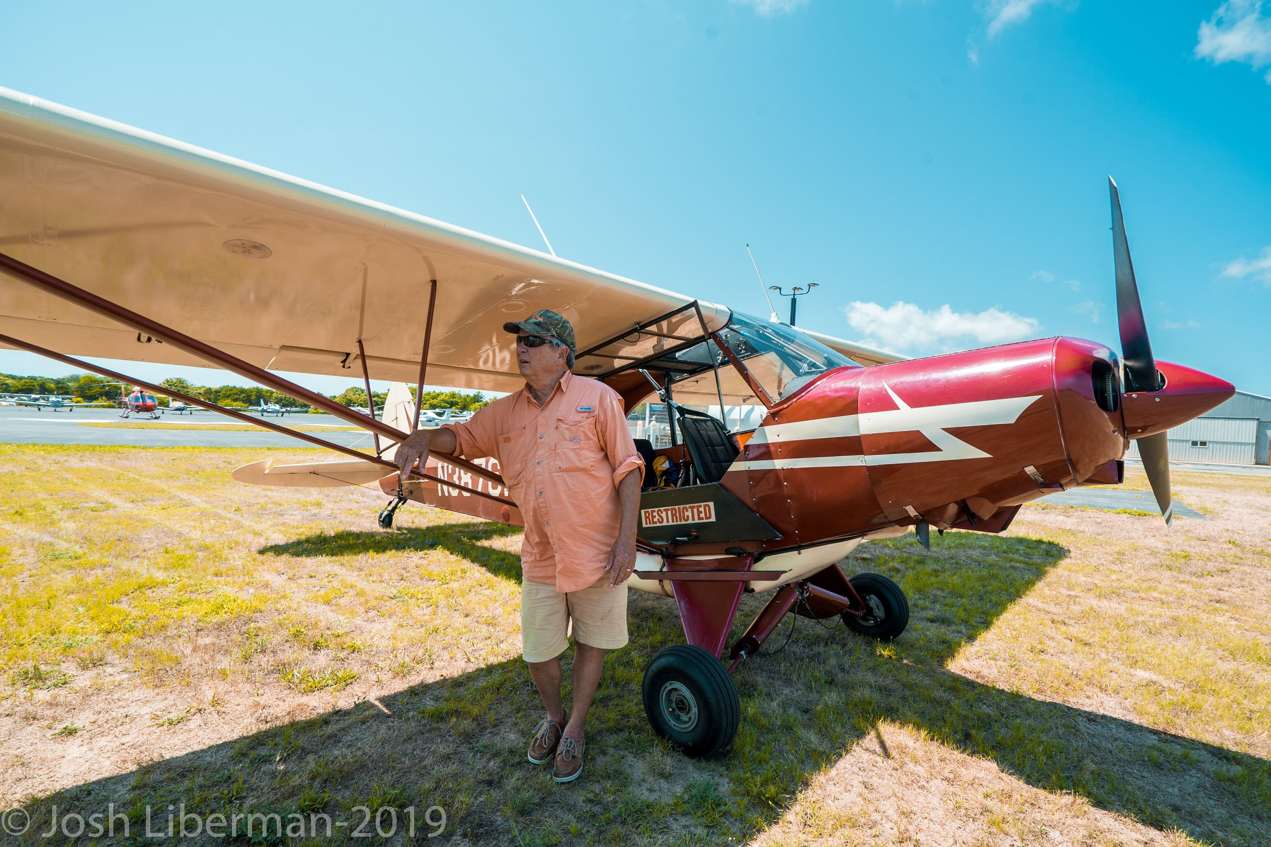 Pilot George Breen stands beside his 1955 Piper Super Cub.