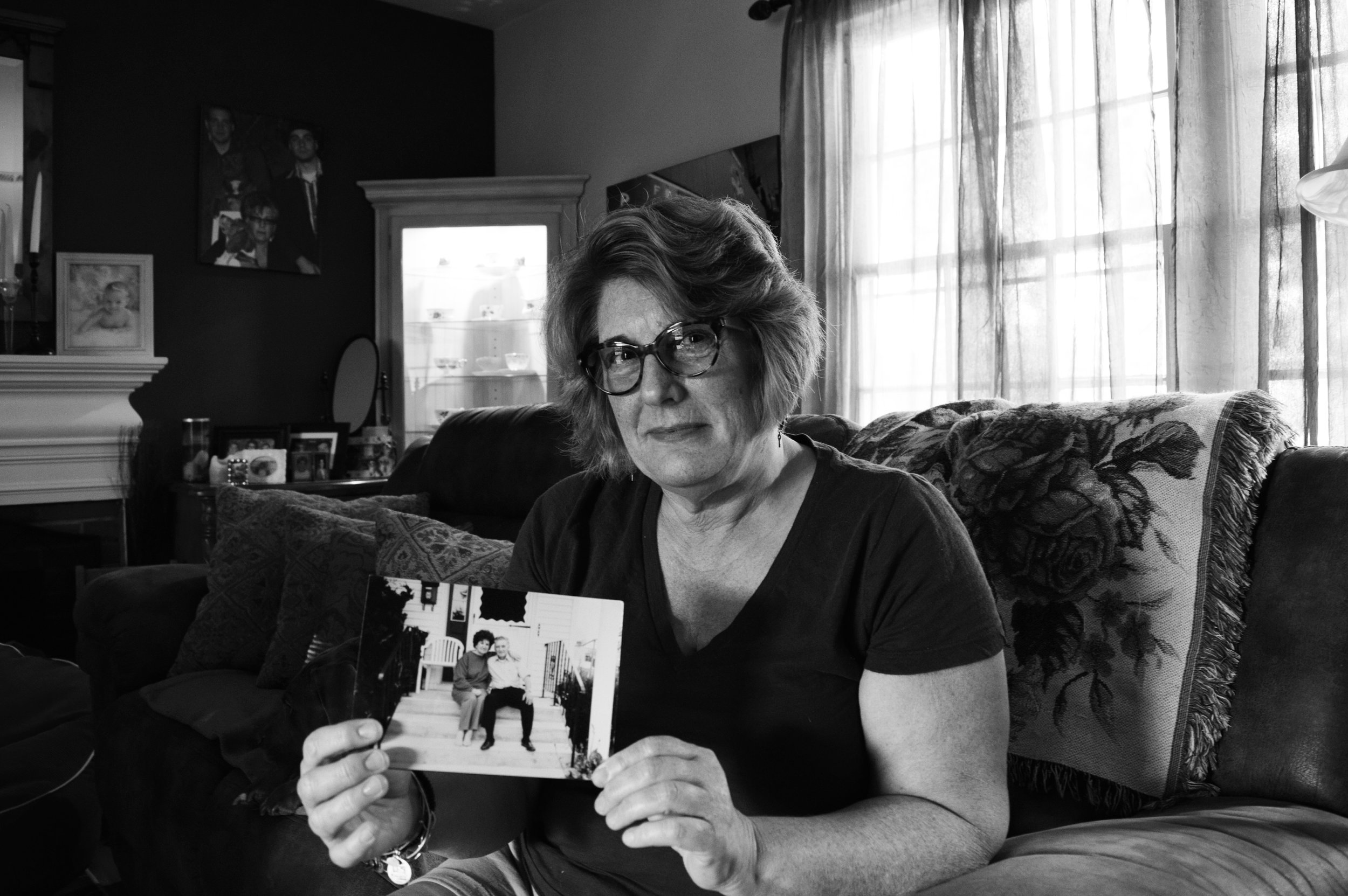 Cynthia holds a photo of her parents in her California home.