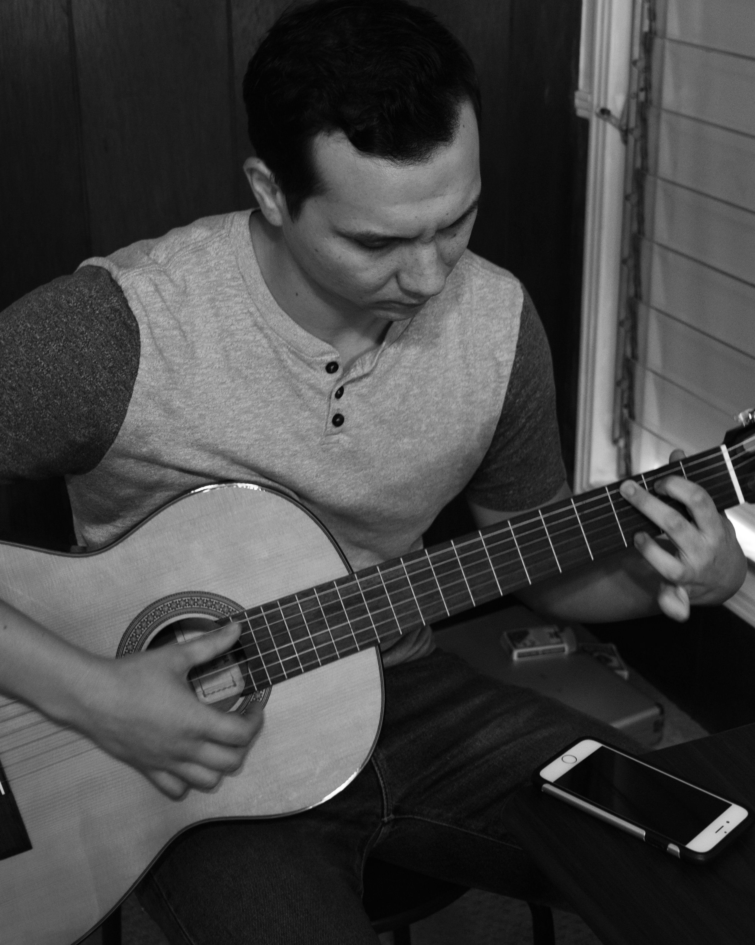 Matt shows more talent by playing a song on the guitar. Soon after this photo was taken, we practiced a call and response exercise together.