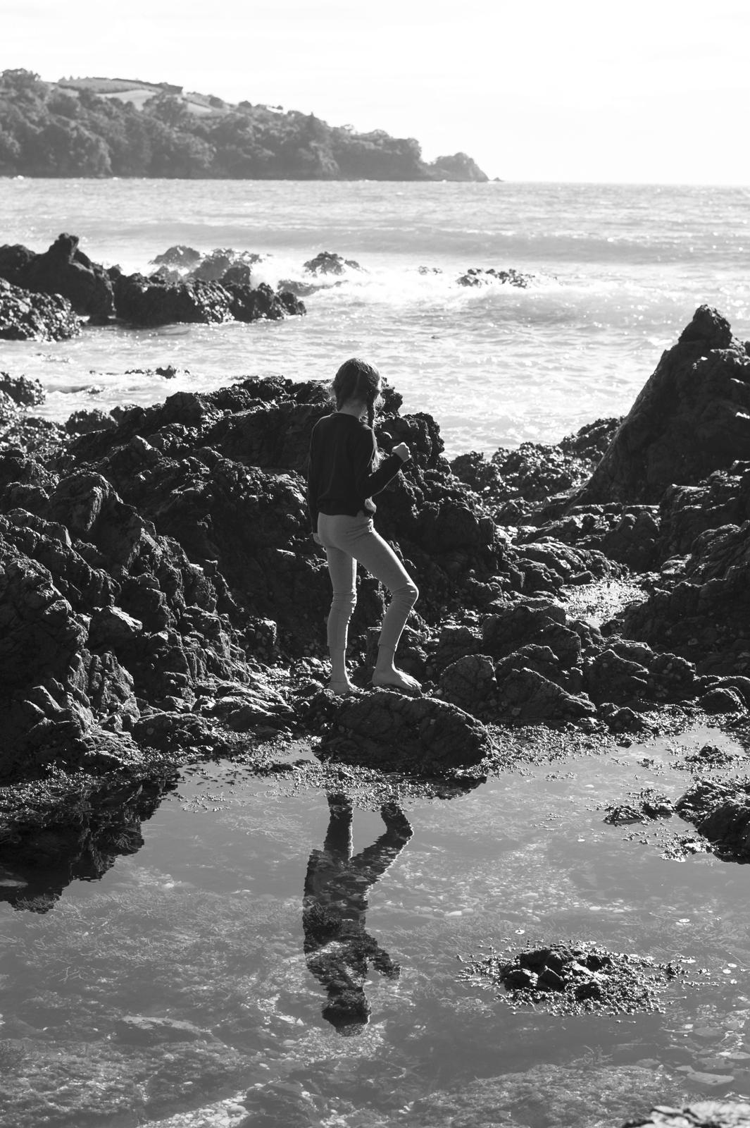 Kira watching the waves crashing