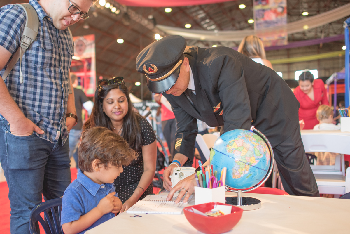 Delta Air Lines pilot helping kids and parents with the journal activities.