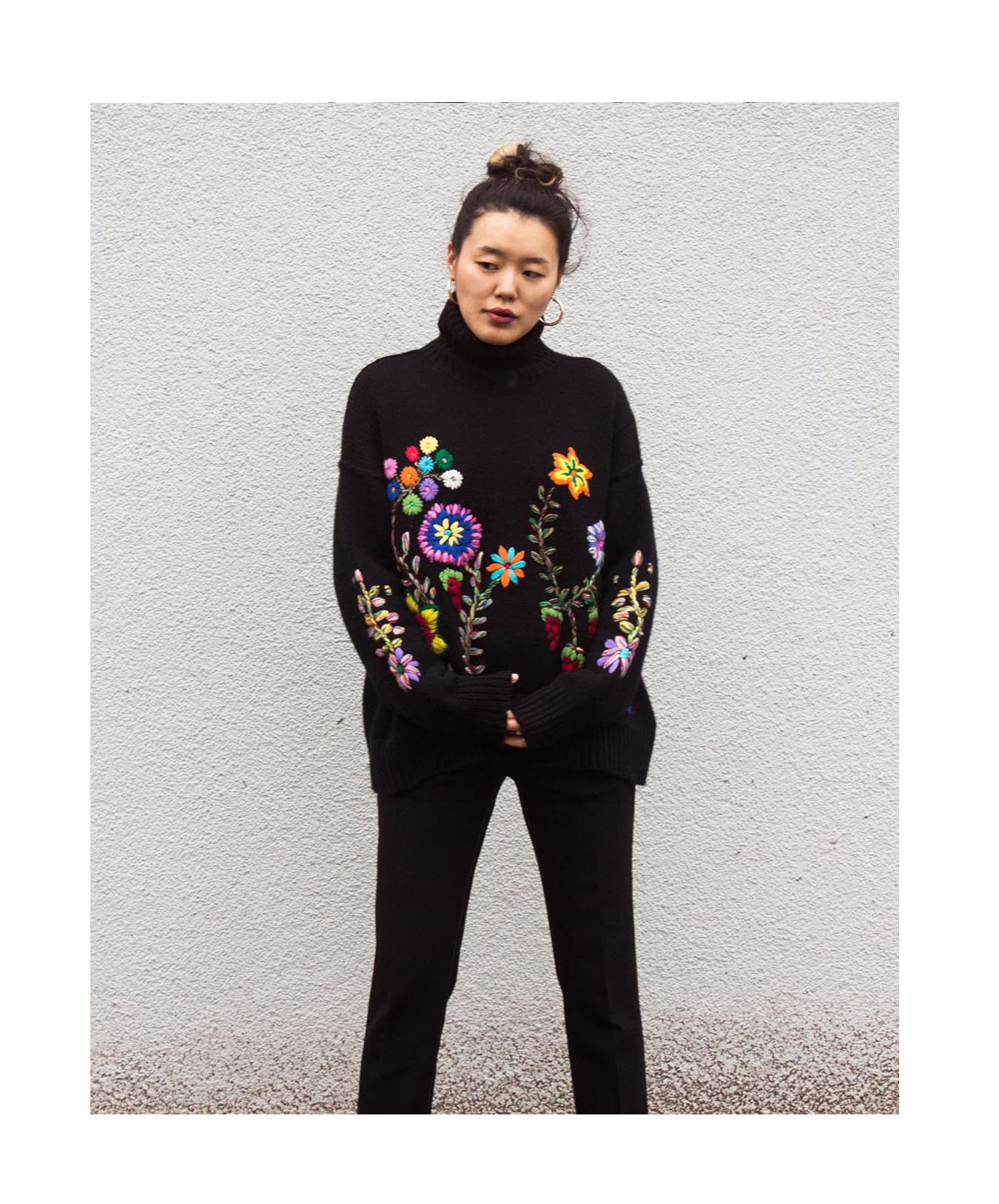 Mandkhai wearing flower embroidered oversized2 jumper