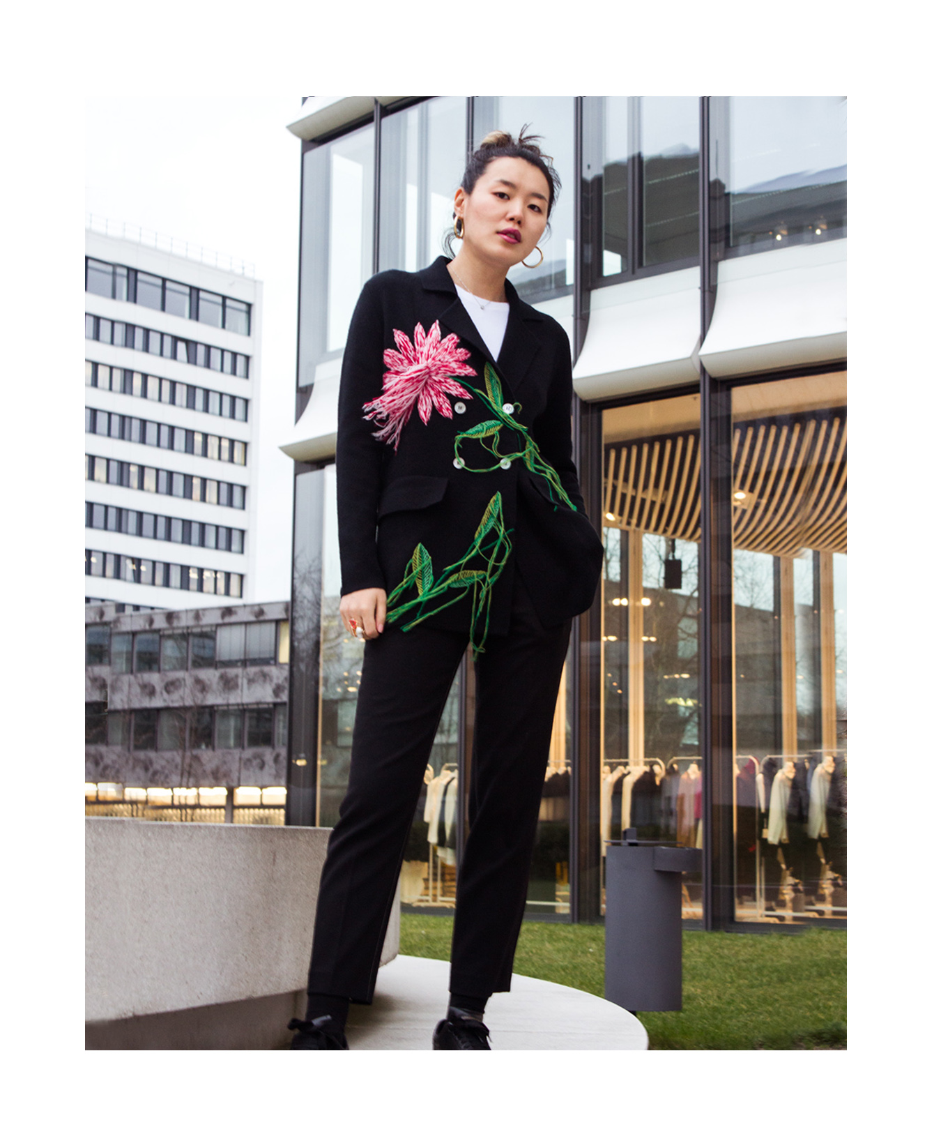 Mandkhai wearing suit blazer in black with embroidered flower
