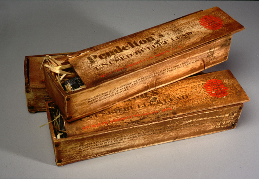 Caught in Man's Amnesia, 2003 3 boxes. Re-melted and cast unused bullet lead salvaged from battlefields of every American war, dirt from battlefields, cast and carved bone granite powder, prosthetic alginate, straw, typeset 5 x 23 x 6,4 cm - 2 x 9 x 2 1/2 inches (each)