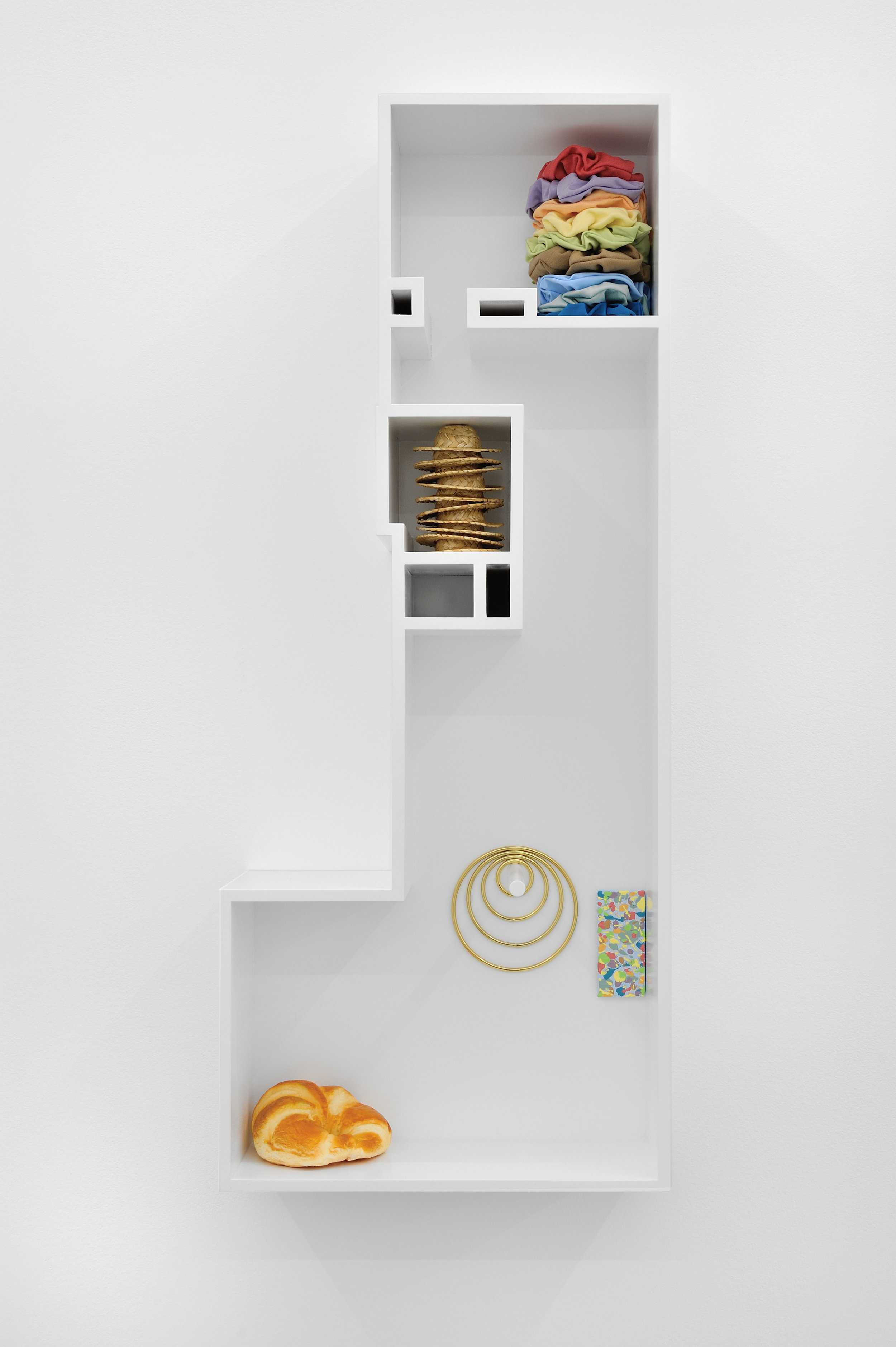 Untitled Model (A STACK OF STRAW HATS), 2015 MDF, poplar, enamel paint, custom scrunchies, a stack of straw hats, brass rings, acrylic on canvas, artificial croissant 86,7 x 35,5 x 16,5 cm - 34 1/8 x 14 x 6 1/2 inches