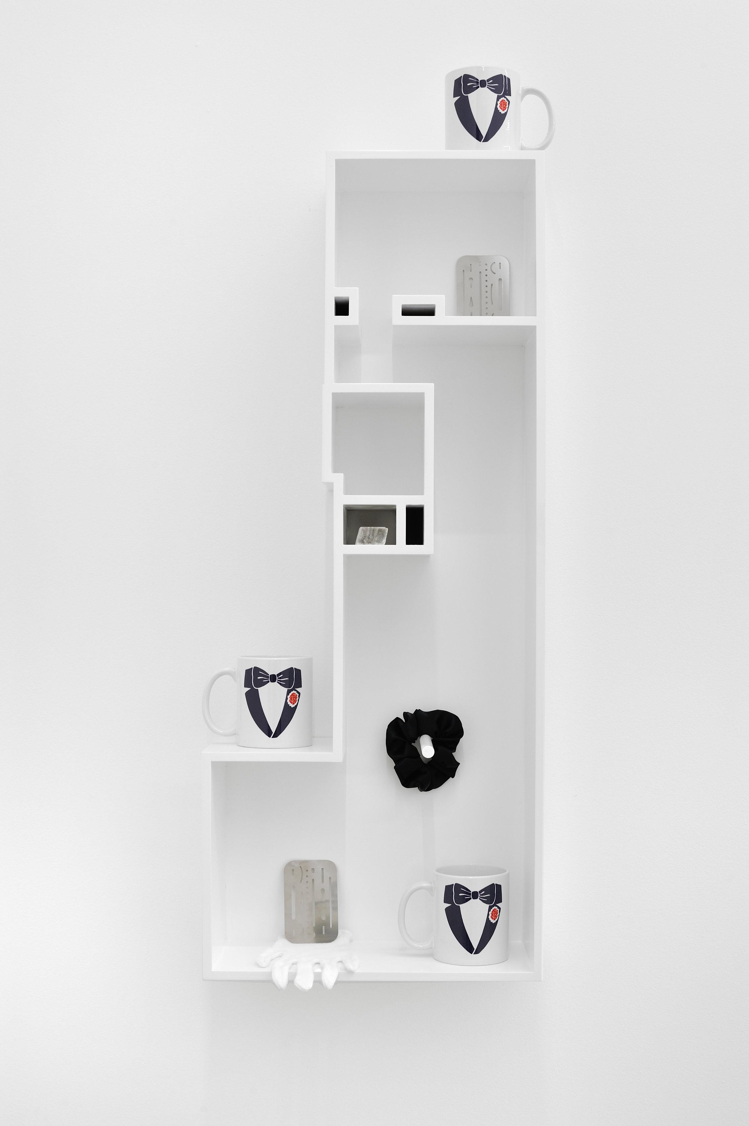 Untitled Model (TRIPLE FORMAL), 2015 MDF, poplar, enamel paint, tuxedo mugs, eraser shields, optical calcite, black scrunchie, preparator's white glove 86,7 x 35,5 x 16,5 cm - 34 1/8 x 14 x 6 1/2 inches
