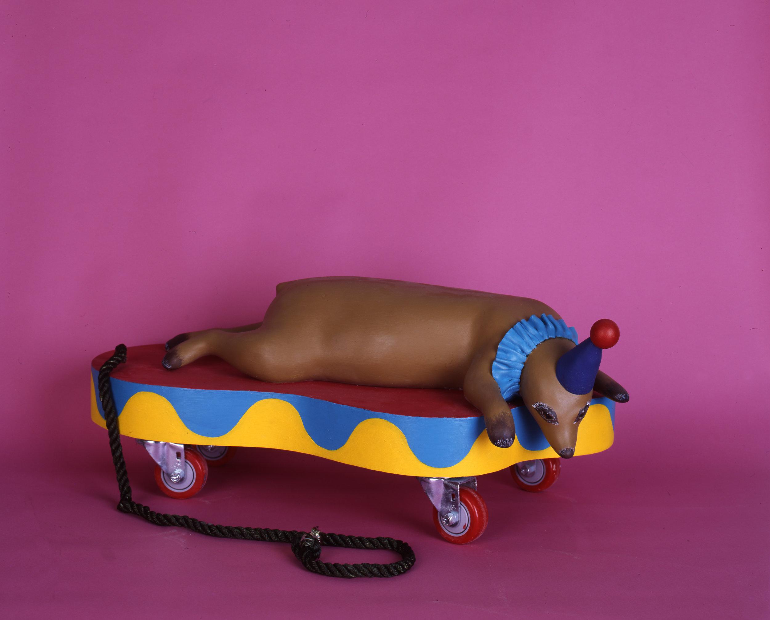 Little Guy, 2008 wood, foam, aqua resin, surfacing veil, plastic, acrylic paint, castor wheels and rope 35,5 x 76 x 40,5 cm - 14 1/32 x 30 x 15 inches