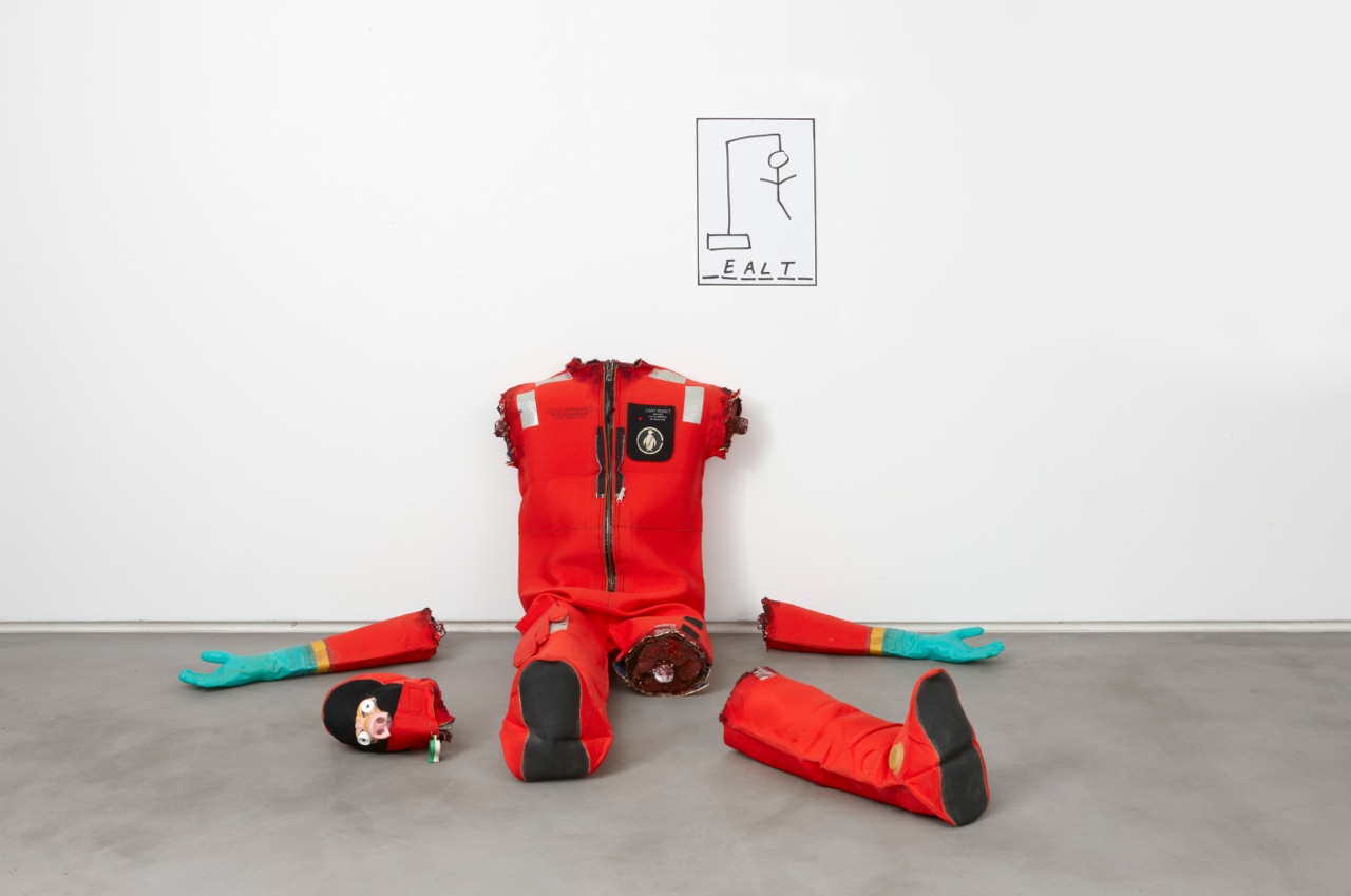 Joel Kyack, Health / Wealth, 2012 cold water survival suit, styrofoam, paint, cardboard, mask, bubble wrap, marker on paper variable dimensions