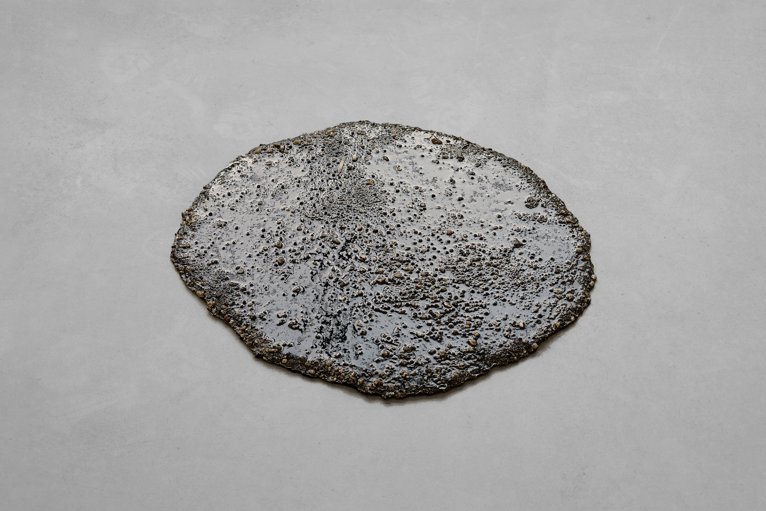 Marlie Mul, Puddle (Brown Grit), 2013 sand, stones, resin diam. 55 cm - 22 inches