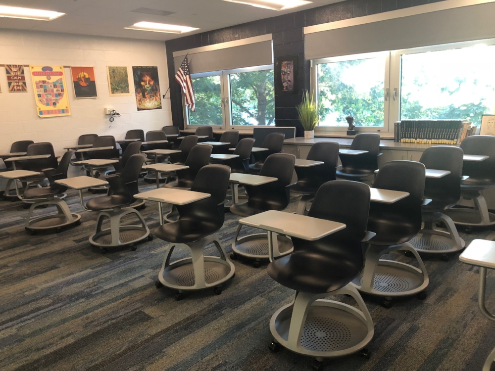 """Derek Williams' room models the new classroom setup. He takes pride in his classroom plants as they """"warm the room"""" to provide a better learning environment  Photo by Tyler Totin"""