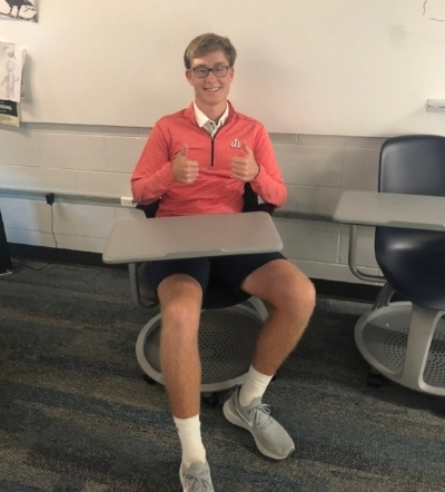 Senior Will Riesenberg gives the new chairs a thumbs up!  Photo by Tyler Totin