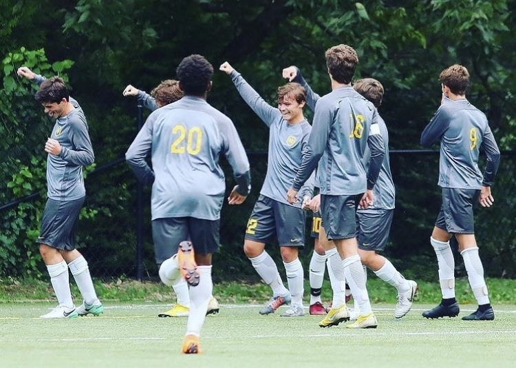 Photo posted to Moeller Soccer's instagram. The team celebration after a goal.