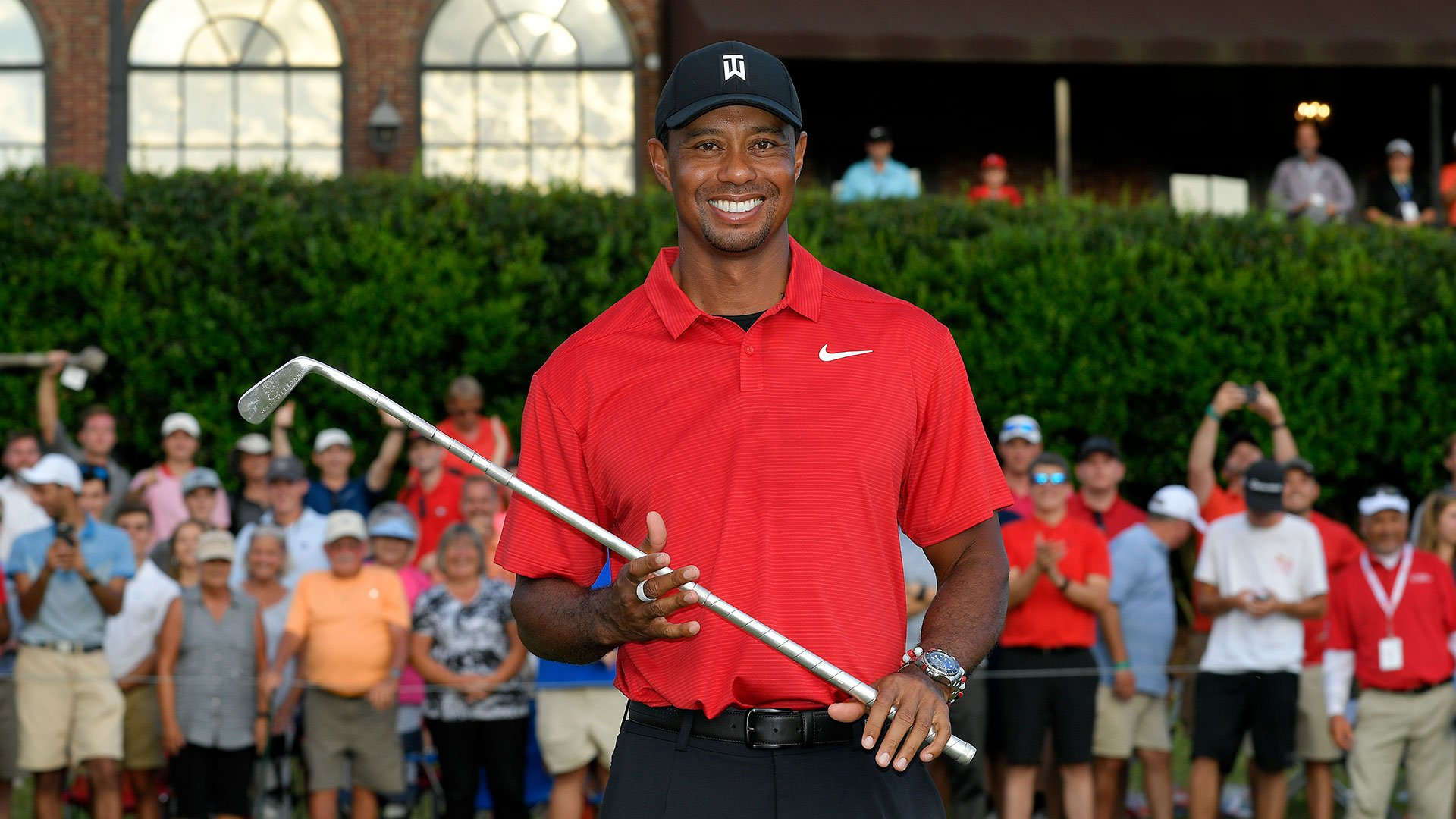 Tiger holding his trophy after his win at the 2018 Tour Championship
