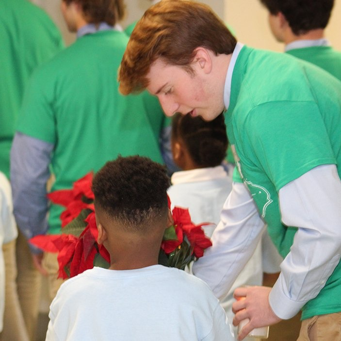 Moeller student with his buddy before mass  By Moeller HS