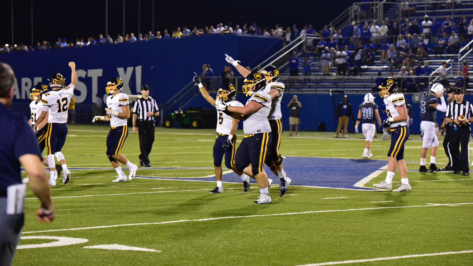 Moeller players celebrating a road GCL win at St. Xavier by letsgobigmoe.com