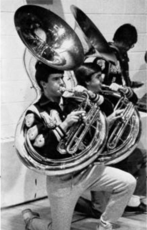 Mike Ward blasting the tuba in the 1986 Moeller Yearbook