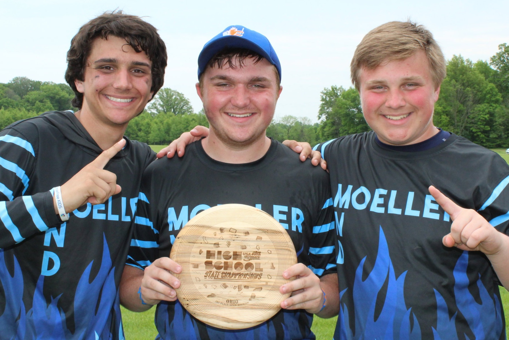 Jimmy, Sam, and Adam holding State Championship Trophy  Picture By: Amy George